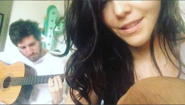Taina Muller e o marido Henrique cantando para o filho (Foto: Reprodução - Instagram)