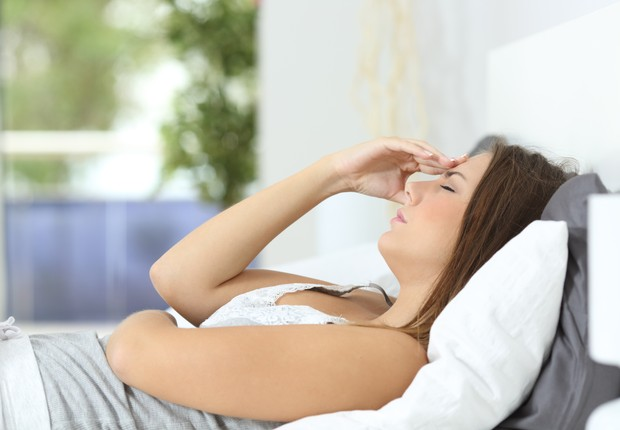 Mulher; menstruação; dor de cabeça; cansaço; estresse (Foto: Thinkstock)