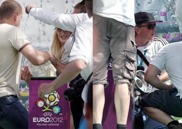 Mulher seminua tenta roubar taça da Eurocopa na Ucrânia (Foto: Efrem Lukatsky/AP)