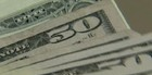 Dólar cai e  fecha cotado  a R$ 2,24 (Reprodução Globo News)