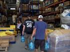 Brasileiros juntam toneladas de doações para vítimas da lama em MG