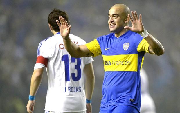 Santiago Silva comemora gol do Boca Juniors contra a U. de Chile (Foto: AFP)