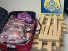 Mulher é presa transportando 15 kg de maconha em ônibus na Dutra