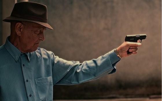 Na pele do pistoleiro Amador, Nelson Xavier fez seu último trabalho no filme Comeback (Foto: Divulgação)