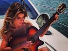 Carol Magalhães faz topless e posta foto em rede social