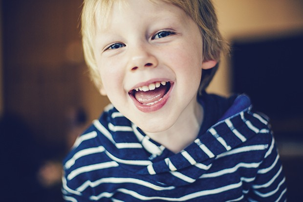crianca-livro-educacao-familia-felicidade (Foto: Sally Anscombe / Getty Images)