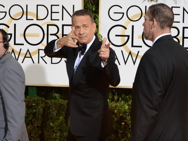 O ator Tom Hanks no tapete vermelho do 71º Globo de Ouro, que acontece neste domingo (12), em Los Angeles. (Foto: Jordan Strauss/Invision/AP)