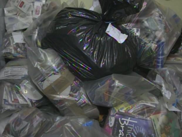 Segundo a polícia, foram apreendidas 60 mil mídias (Foto: Reprodução/ TV TEM)