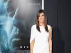 Sandra Bullock, Katie Holmes e Emma Watson usam vestidos curtinhos