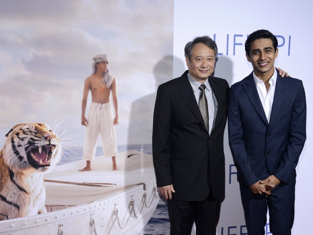 Cineasta Ang Lee e ator Suraj Sharma em estreia de 'As aventuras de Pi' em 16 de novembro na cidade de Los Angeles (Foto: Phil McCarten/Reuters)