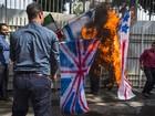 Estudantes de milícia iraniana queimam 'bandeiras inimigas'