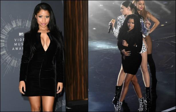 Tudo parecia normal com o vestido de Nicki Minaj no tapete vermelho do VMA 2014, em agosto. Porém, ao subir no palco para cantar com Adriana Grande e Jessie J., a intérprete de 'Anaconda' não ficou nada à vontade. Passou mais de dois minutos da apresentaç (Foto: Getty Images)