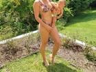 Bella Falconi exibe ótima forma física em banho de sol com a filha
