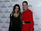 Cleo Pires e Carolina Ferraz usam looks decotados para curtir festa