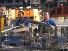 Construção civil e indústria de transformação encolhem em 2014