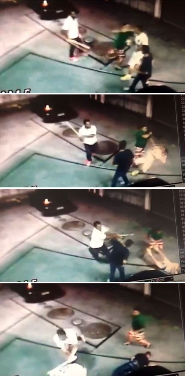 Câmera de segurança registra torcedores do Santos sendo agredidos com soco e pauladas em São Paulo (Foto: Reprodução GloboNews)