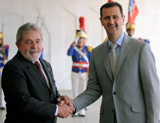 O o ex-presidente Lula e Bashar al-Assad  (Foto: EVARISTO SA/AFP)