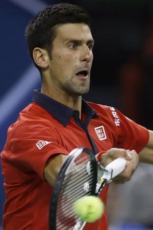 Novak Djokovic x Martin Klizan Masters 1000 Xangai tenis (Foto: Reuters)