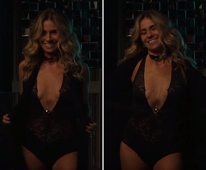 Atena usa body preto de renda com decote profundo (Foto: Globo)