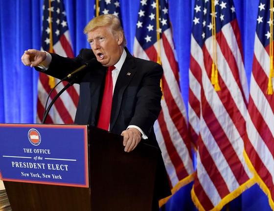 Trump ,na primeira entrevista coletiva.Bate-boca com jornalistas em clima de reality show (Foto: TIMOTHY A. CLARY/AFP)