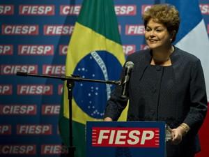 Presidente Dilma Rousseff durante encontro com empresários e o presidente francês, François Hollande (Foto: AFP)
