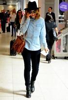 Look do dia: Leandra Leal usa chapéu para viajar