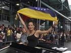 Venezuelanos viajam para votar nos EUA (Jose Caruci/Handout/Reuters)