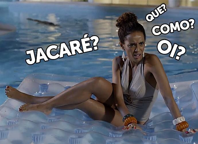 Michele entra na piscina com jacaré (Foto: TV Globo)