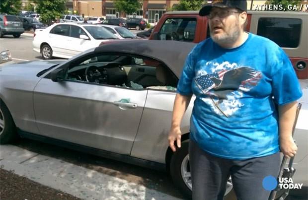 Michael Hammons foi preso por arrombar carro para ajudar cão deixado em carro (Foto: Reprodução/YouTube/USA Today)