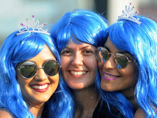 Fãs usam perucas coloridas no 7º dia de Rock in Rio (Foto: Alexandre Durão/G1)