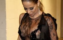 De look transparente e sem sutiã, Danielle Winits revela intimidade