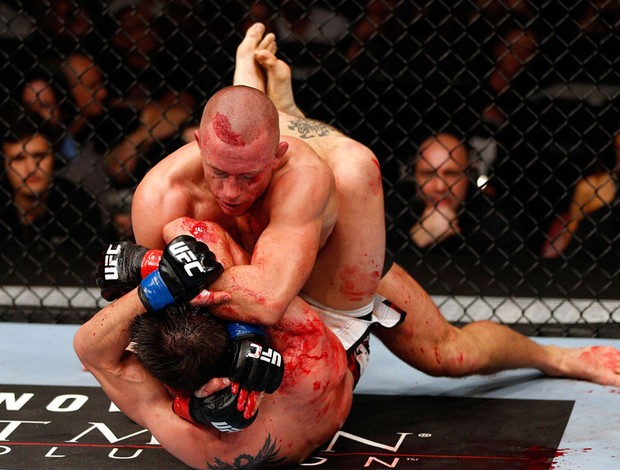 UDC 154  Carlos Condit e Georges St-Pierre (Foto: Agência Getty Images)