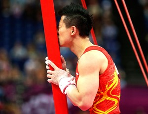 Yibing Chen ap&#243;s a prova de argolas Londres (Foto: AP)