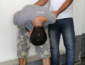Homem é preso por pichar monumento em BH (Foto: Sara Antunes / G1/MG)