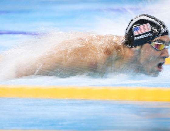 Michael Phelps durante semifinal dos 100m borboleta na piscina do Parque Olímpico (Foto: Ricardo Nogueira/ÉPOCA)