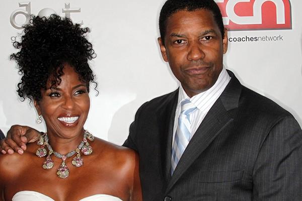 Denzel Washington conheceu sua esposa, Pauletta, no set de filmagem de 'Wilma', seu primeiro trabalho em frente às telas. O casal juntou os trapos em 1983 e está junto até hoje, com quatro filhos na bagagem. (Foto: Getty Images)