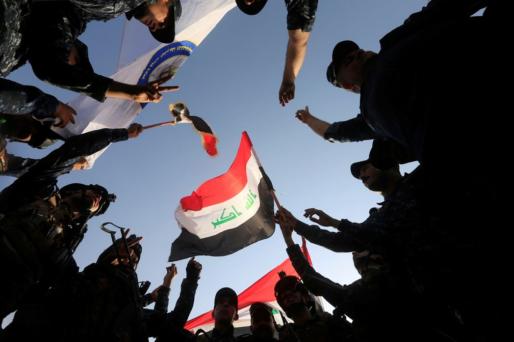 Polícia Federal do Iraque comemora retomada de Mossul neste domingo (9) (Foto: REUTERS/Alaa Al-Marjani)