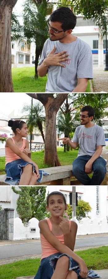 Delmir se comunica em libras com Raíssa, de 11 anos, lavras (Foto: Samantha Silva/G1)