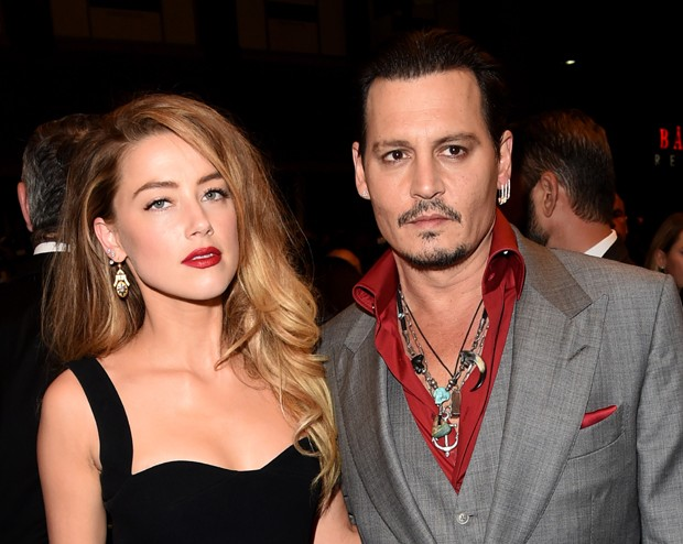 Amber Heard e Johnny Depp, agora separados (Foto: Jason Merritt/Getty Images)