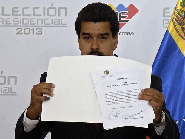 O Conselho Nacional Eleitoral da Venezuela proclamou nesta segunda-feira (15) Nicolás Maduro como novo presidente, um dia após a vitória dele sobre Henrique Capriles nas urnas (Foto: Juan Barreto/AFP)