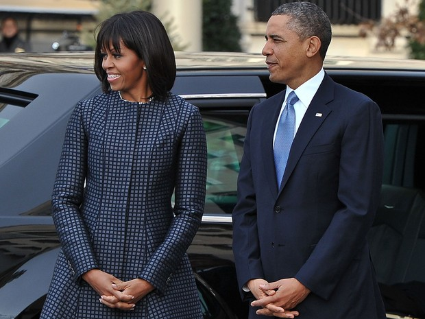Barack Obama e sua mulher, Michelle, na chegada à Igreja de St. John. (Foto: Nicholas Kamm/AFP)