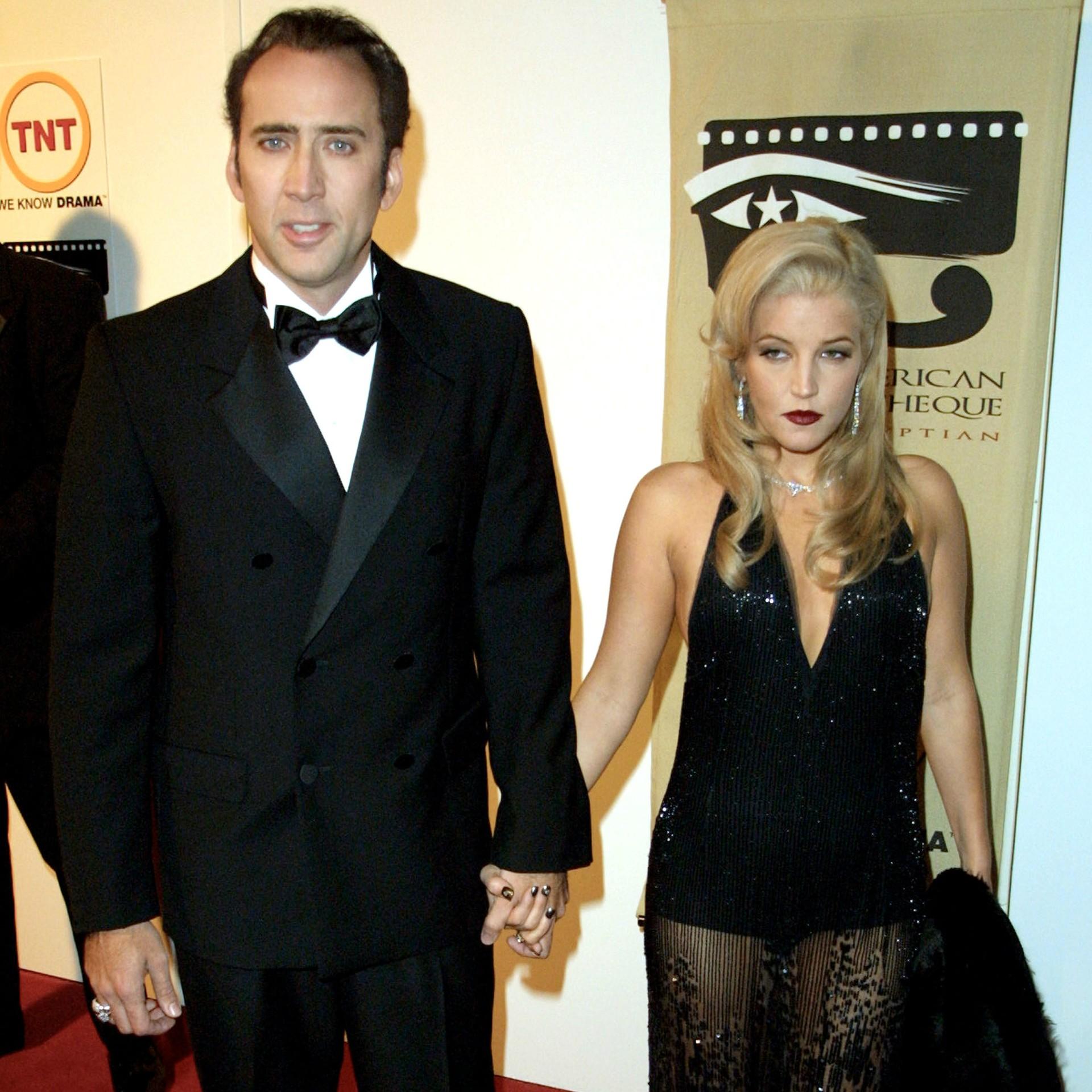 O ator Nicolas Cage, de 50 anos, se casou com a filha de Elvis Presley, Lisa Marie Presley, de 46, em agosto de 2002. Antes de aquele ano acabar, os dois já estavam se divorciando. (Foto: Getty Images)