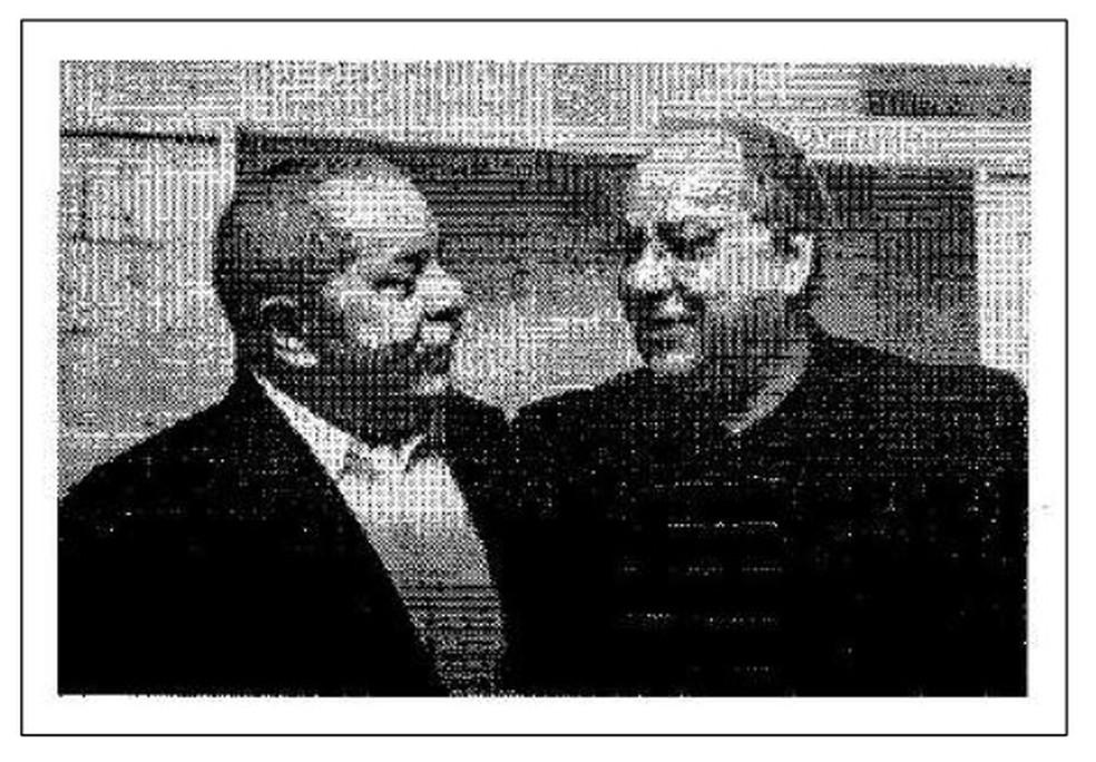 Esta imagem em preto e branco, que mostra Lula e Duque, foi anexada pelos advogados do ex-diretor nos documentos protocolados  (Foto: Eproc/Reprodução)