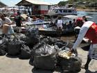 Praticantes de SUP limpam margem de igarapé em ação voluntária no AM