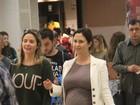 Guilhermina Guinle desfila o barrigão em aeroporto do Rio