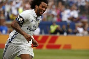 Marcelo comemora gol pelo Real Madrid (Foto: EFE/JEFF KOWALSKY)