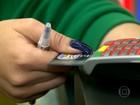Brasileiros adiam pagamento das dívidas e caem nos juros