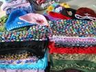 Faculdade em São Vicente recebe doações de lenços, tecidos e toucas