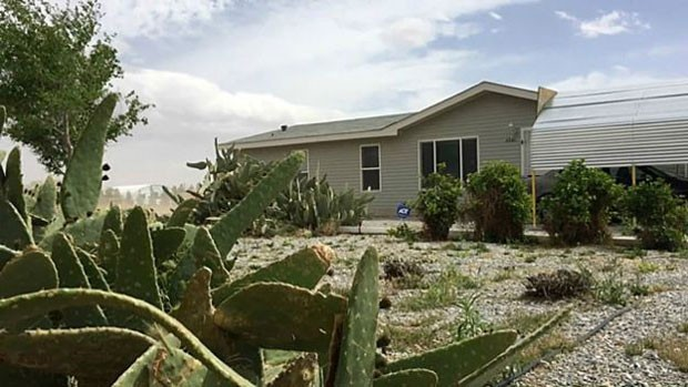 Wayne mora em uma casa simples em Nevada, a 800 quilômetros da sede da Apple, na Califórnia (Foto: BBC)