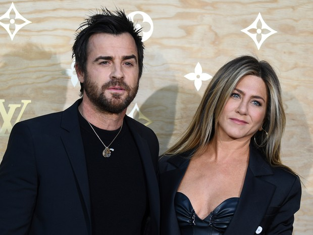 Justin Theroux e Jennifer Aniston em evento de moda em Paris, na França (Foto: Gabriel Bouys/ AFP)